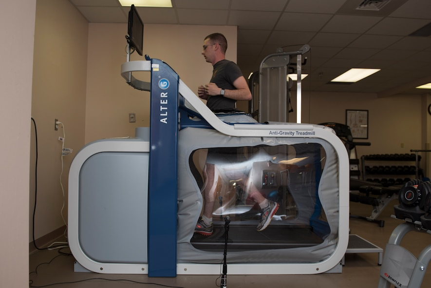 Michael Chitwood, physical therapy patient, runs on an anti-gravity treadmill at the 27th Special Operations Medical Group Physical Medicine Office April 26, 2017, at Cannon Air Force Base, NM. An anti-gravity treadmill allows the patient to run at a percentage of their bodyweight and adjust that percentage over time as they get stronger. (U.S. Air Force photo by Staff Sgt. Michael Washburn/Released)