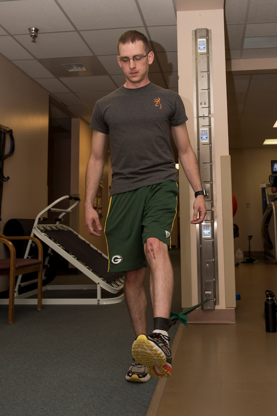 Michael Chitwood, physical therapy patient, performs leg exercises at the 27th Special Operations Medical Group Physical Medicine Office April 26, 2017, at Cannon Air Force Base, NM. The different color bands have different resistances and patients can utilize the bands to increase the strength of the muscles in their arms or legs. (U.S. Air Force photo by Staff Sgt. Michael Washburn/Released)