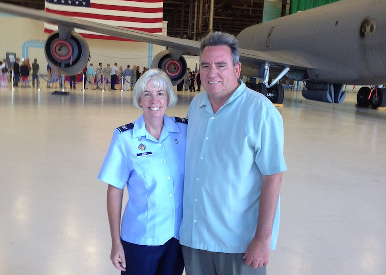 Col. Meg Carey, 92nd Medical Group commander, and her husband Curt Carey pose for a photo May 17, 2014, at Fairchild Air Force Base, Washington. Col. Carey has served the in the Air Force since 1991, joining team Fairchild in 2014.