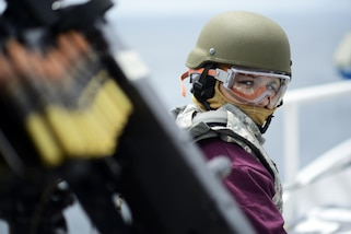 Seaman Mia Mauro, stationed on the Coast Guard Cutter Winslow Griesser, prepares to shoot the .50 cal machine gun during a joint gunnery exercise between allied and partner nations in the Caribbean Sea, June  8, 2017 during Tradewinds. Tradewinds 2017 is a joint combined exercise conducted in conjunction with partner nations to enhance the collective abilities of defense forces and constabularies to counter transnational organized crime and to conduct humanitarian/disaster relief operations. U.S. Coast Guard photo by Petty Officer 2nd Class Adam Stanton