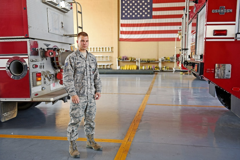 U.S. Air Force Staff Sergeant Zachary White, 612th Air Base Squadron, Fire Emergency Services crew chief, poses for a photograph at the Soto Cano Fire Department at Soto Cano Air Base, May 25th, 2017. Staff Sgt. White is in charge of deciding how his team of four responds to a fire emergency.   (U.S. Army photo by Maria Pinel)