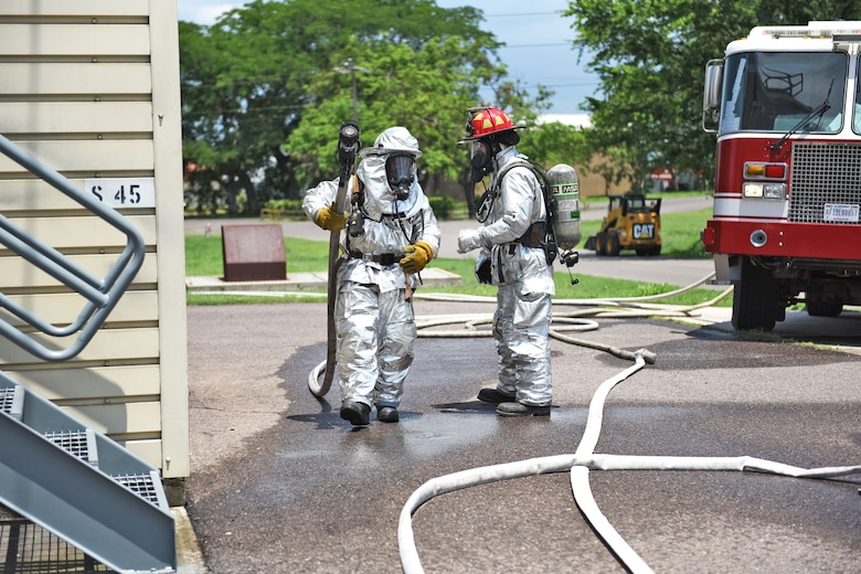 U.S. Air Force Staff Sergeant Zachary White (right), 612th Air Base Squadron, provides guidance for a fellow Airman during a simulated call to action exercise in response to a fire emergency at Soto Cano Air Base, May 25th, 2017. Striving to maintain readiness among his team, he constantly teaches them the proper procedures to prepare and respond to an emergency situation.  (U.S. Army photo by Maria Pinel)