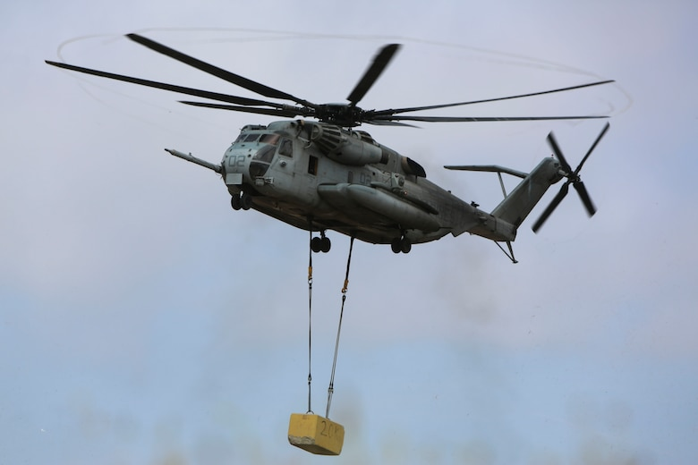 A CH-53E Super Stallion carries a 20,000 pound training load during external lift training at Marine Corps Base Camp Pendleton, California, June 5. Helicopter Support Team (HST) Marines with Combat Logistics Battalion (CLB) 5 supported Marine Heavy Helicopter Squadron (HMH) 466 during the external lift exercise, securing the training load to the CH-53E ensuring the aircraft carried the load safely.