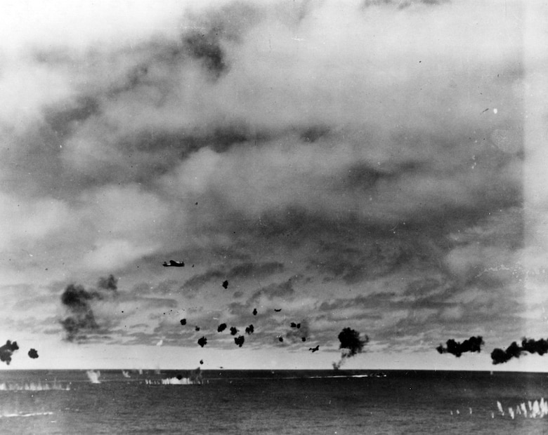 Japanese Type 97 shipboard attack aircraft from the carrier Hiryu amid heavy anti-aircraft fire, during the torpedo attack on USS Yorktown (CV-5) in the mid-afternoon, 4 June 1942. At least three planes are visible, the nearest clearly having already dropped its torpedo. The other two are lower and closer to the center, apparently withdrawing. Smoke on the horizon in right center is from a crashed plane. It is possible that the object very close to the horizon, in center, is another attacking aircraft. Official U.S. Navy Photograph, now in the collections of the U.S. National Archives.  Source:  (U.S. Navy)