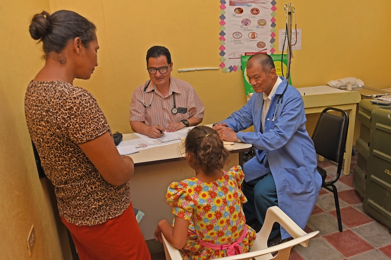 Dr. Carlos Duron (left) and U.S. Army Lt. Col. (Dr.) Jack Leong, Joint Task Force-Bravo Medical Element, see patients at the Regional Health Center in the Tepanguare village located in La Paz, Honduras, May 24, 2017. The doctors participated in a monthly visit to the clinic where they provide free consultations and medications to the local population from Tepanguare and neighboring communities.