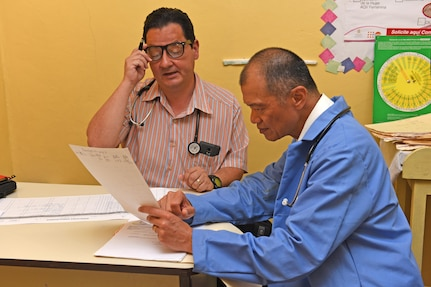 Dr. Carlos Duron (left) and Lt. Col. (Dr.) Jack Leong, Joint Task Force-Bravo Medical Element, review patient records at the Regional Health Center in the Tepanguare village located in La Paz, Honduras, May 24, 2017. The doctors participated in a monthly visit to the clinic where they provide free consultations and medications to the local population from Tepanguare and neighboring communities.