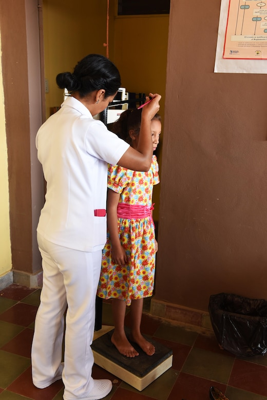 Rina Castillo, a local nurse weighs a child prior to seeing a medical staff from Joint Task Force-Bravo's Medical Element at the Regional Health Center in the Tepanguare village located in La Paz, Honduras, May 24, 2017. Doctors from Joint Task Force-Bravo's Medical Element support the clinic by providing free consultations every four weeks at the understaffed center, caring for patients and providing medications.