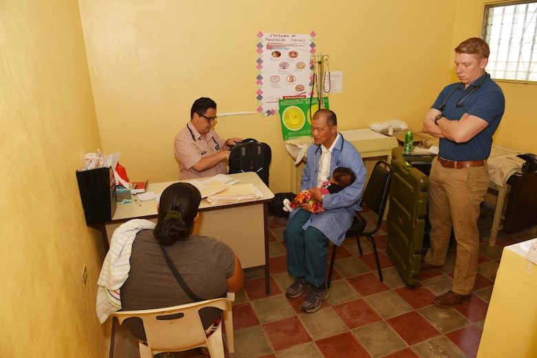 Dr. Carlos Duron (left), U.S. Army Lt. Col. (Dr.) Jack Leong (center) and U.S. Army Spc. Timothy Morrison, Joint Task Force-Bravo Medical Element, receive patients at the Regional Health Center in the Tepanguare village located in La Paz, Honduras, May 24, 2017. The MEDEL staff participated in a monthly visit to the clinic where they provide free consultations and medications to the local population from Tepanguare and neighboring communities.