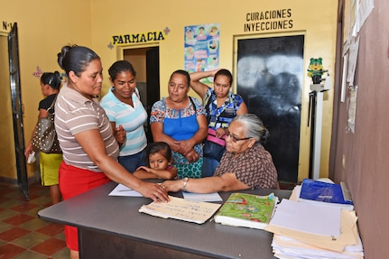 Maria Cruz, a local nurse, signs in patients prior to receiving care from a team of Joint Task Force-Bravo's Medical Element, at the Regional Health Center in the Tepanguare village located in La Paz, Honduras, May 24, 2017. The team of three participated in a monthly visit to the clinic where they provide free consultations and medications to the local population from Tepanguare and neighboring communities.