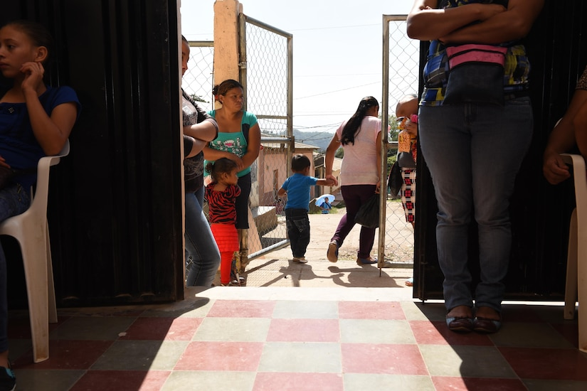 Patients exit the Regional Health Center in the Tepanguare village located in La Paz, Honduras, May 24, 2017 after receiving medical services from Joint Task Force-Bravo's Medical Element personnel. The MEDEl staff supports the clinic by providing free consultations every four weeks at the understaffed center, caring for patients and providing medications.