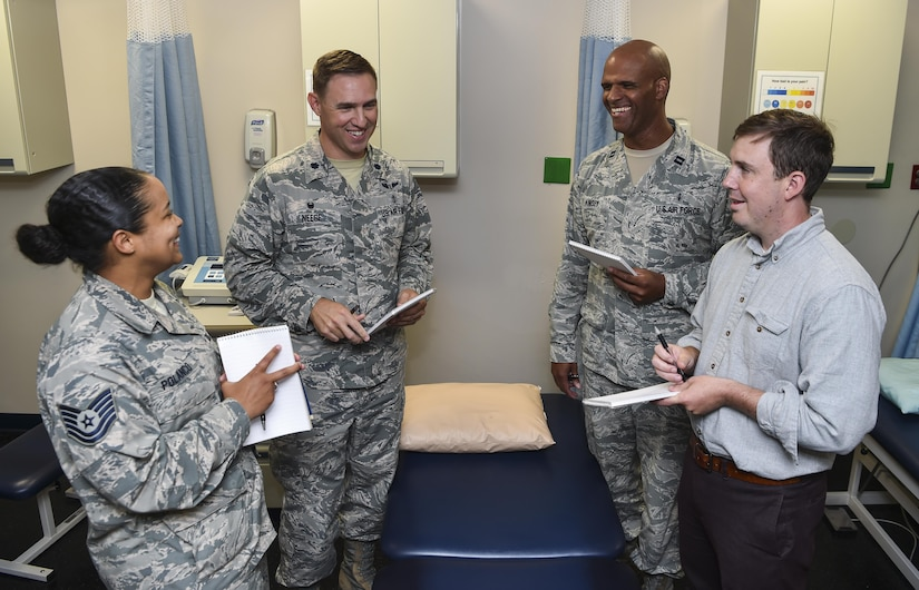 Lt. Col. Brian Neese, 628th Medical Operations Squadron commander, talks with other members of the 628th MDOS at Joint Base Charleston, S.C., June 8, 2017. Neese won the Federal Health Care Executive Special Achievement Award which recognizes him and his unit for exceeding Air Force standards.