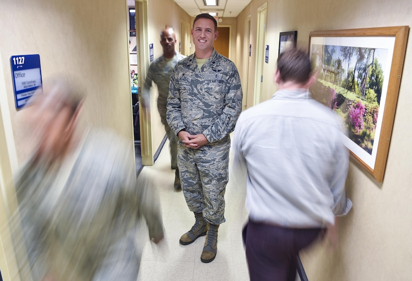 Lt. Col. Brian Neese, 628th Medical Operations Squadron commander, stands in a medical group clinic hallway at Joint Base Charleston, S.C., June 8, 2017. Neese won the Federal Health Care Executive Special Achievement Award which recognizes him and his unit for exceeding Air Force standards and is awarded to a federal career health care executive who has distinguished themselves through singularly significant achievements which have contributed substantially to the mission of the federal health care system.