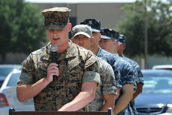 Staff Sgt. Christopher Champagne, Keesler Marine Detachment instructor supervisor, delivers remarks during the Battle of Midway Commemoration Ceremony hosted by CNATTU Keesler June 7, 2017, on Keesler Air Force Base, Miss. The ceremony commemorated the 75th anniversary of the Battle of Midway, which was a U.S. naval victory during World War II. (U.S. Air force photo by Kemberly Groue)