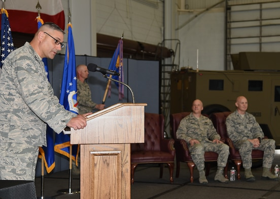 Col. Stephen Kravitsky, 90th Missile Wing commander, speaks at the 90th Security Forces Group Change of Command in the Peacekeeper High Bay on F.E. Warren Air Force Base, Wyo., June 9, 2017. Kravitsky spoke of Col. Christopher Corley's achievements in his tenure at the 90th SFG, as well as why Col. John Grimm is the right man to succeed Corley and assume command of the group. (U.S. Air Force photo by Glenn S. Robertson)