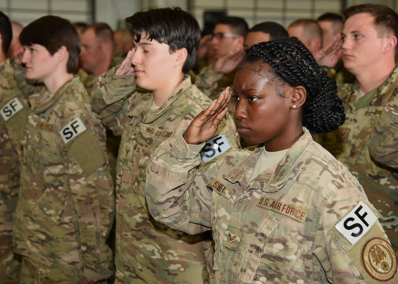 Defenders in the 90th Security Forces Group render a final salute to Col. Christopher Corley, their outgoing commander, at the 90th SFG Change of Command in the Peacekeeper High Bay on F.E. Warren Air Force Base, Wyo., June 9, 2017. Corley assumed command of the group during the ceremony which represents a formal transition of authority from the outgoing commanding to the incoming commander. (U.S. Air Force photo by Glenn S. Robertson)