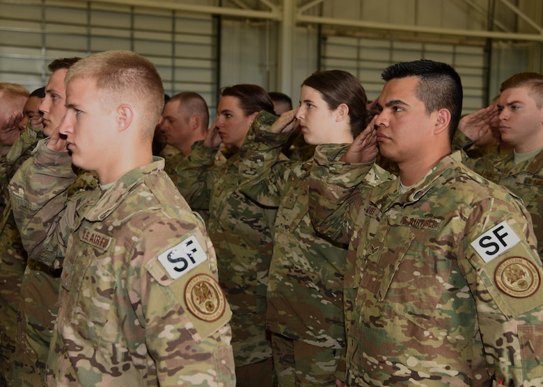 Defenders in the 90th Security Forces Group render a salute to Col. John Grimm, their commander, at the 90th SFG Change of Command in the Peacekeeper High Bay on F.E. Warren Air Force Base, Wyo., June 9, 2017. Grimm assumed command of the group during the ceremony which represents a formal transition of authority from the outgoing commanding to the incoming commander. (U.S. Air Force photo by Glenn S. Robertson)