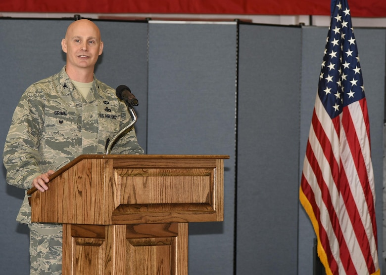 Colonel John Grimm, 90th Security Forces Group commander, speaks to the crowd attending the 90th SFG Change of Command June 9, 2017, in the Peacekeeper High Bay on F.E. Warren Air Force Base, Wyo. Grimm assumed command of the largest security forces group in the U.S. Air Force. (U.S. Air Force photo by Glenn S. Robertson)