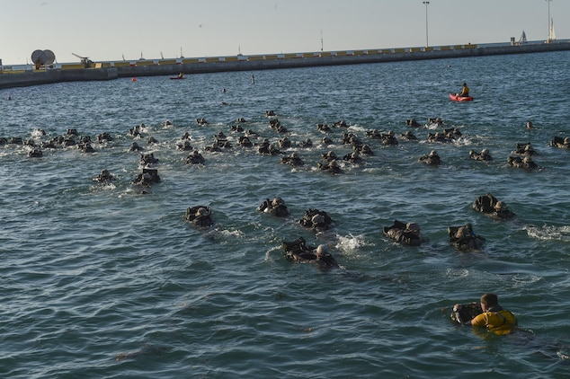 Marine Special Operations School Individual Training Course students perform a 2,000 meter swim, March 20, 2017, at Key West, Fla. For the first time, U.S. Air Force Special Tactics Airmen spent three months in Marine Special Operations Command's initial Marine Raider training pipeline, representing efforts to build joint mindsets across special operations forces.  (U.S. Air Force photo by Senior Airman Ryan Conroy)