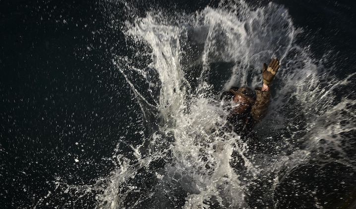 A U.S. Marine practices helocasting off a sea wall during Marine Special Operations School's Individual Training Course, March 21, 2017, at Key West, Fla. For the first time, U.S. Air Force Special Tactics Airmen spent three months in Marine Special Operations Command's initial Marine Raider training pipeline, representing efforts to build joint mindsets across special operations forces.  (U.S. Air Force photo by Senior Airman Ryan Conroy)