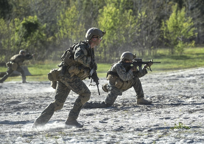 Marine Special Operations School Individual Training Course students run toward targets during live-fire maneuvering training, April 11, 2017, at Camp Lejeune, N.C. For the first time, U.S. Air Force Special Tactics Airmen spent three months in Marine Special Operations Command's initial Marine Raider training pipeline, representing efforts to build joint mindsets across special operations forces.  (U.S. Air Force photo by Senior Airman Ryan Conroy)