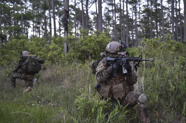 A U.S. Air Force Special Tactics officer with the 24th Special Operations Wing provides rear security during a troop movement at Field Training Exercise Raider Spirit, May 1, 2017, at Camp Lejeune, N.C. For the first time, Special Tactics Airmen spent three months in Marine Special Operations Command's initial Marine Raider training pipeline, representing efforts to build joint mindsets across special operations forces.  (U.S. Air Force photo by Senior Airman Ryan Conroy)