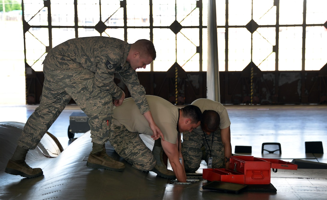Staff Sgt. Dawson Parker, 364th Training Squadron electrical and environmental systems apprentice course instructor, directs his students, Airmen Trenton Jackson and Tyler Bethone, on how to replace the bleed air check valve at Sheppard Air Force base, Texas. The valve prevents shutdown of the environmental control system, which if shut down would result in loss of the anti-G system that prevents the pilot from passing out due to the severe effects of G-force. (U.S. Air Force photo by Senior Airman Robert L. McIlrath)