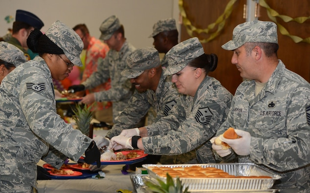 Team McChord leadership and first sergeants prepare plates for Airmen and their families at the Hearts Apart dinner June 6, 2017, at Joint Base Lewis-McChord, Wash. The semi-annual event was hosted by the McChord Chapel, commanders, senior enlisted and first sergeants to support families of deployed Airmen. (U.S. Air Force photo/Senior Airman Jacob Jimenez)