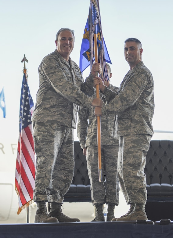 Lt. Col. Robert W. Ryder, (right) 437th Air Maintenance Squadron outgoing commander, passes the guideon to Col. Brian C. Peters, 437th Maintenance Group commander, officially relinquishing his position during a change of command ceremony at Joint Base Charleston June 9, 2017. Ryder had commanded the 437th AMXS since 2015.