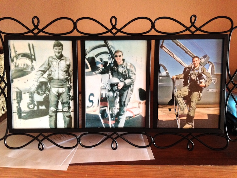 "The hero shots of retired Maj. Ernest Curtis ""Curt"" Hughes, retired Lt. Col. Curtis ""Custis"" Hughes and 2nd Lt. Curtis Hunter Hughes, Specialized Undergraduate Pilot Training Class 17-10 graduate, are displayed proudly by the Hughes family. Hunter's graduation June 9, 2017, makes him the third in a family of fighter pilots. (Courtesy photo)"