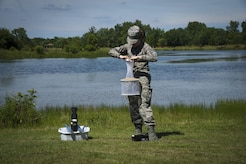 Airman 1st Class Samantha Yordy, 779th Medical Group public health technician, sets mosquito traps at the base lake on Joint Base Andrews, Md., June 8, 2017. Airmen from public health set traps about twice a week. (U.S. Air Force photo by Senior Airman Mariah Haddenham)