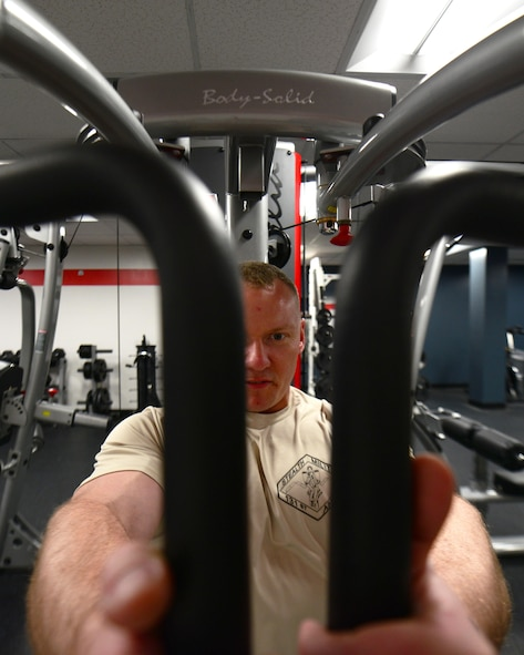 U.S. Air Force Master Sgt. Jonathon Hamilton, a weapons load crew member from the 131st Aircraft Maintenance Squadron, works out at the new flightline gym at Whiteman Air Force Base, Mo., May 30, 2017. The flightline gym was recently renovated to benefit flightline personnel wanting to get a workout in without having to leave the flightline. The renovations were a direct result of the Air Force Global Strike Command's Year of the Family initiative to improve Airmen workcenters. (U.S. Air Force photo by Senior Airman Joel Pfiester)