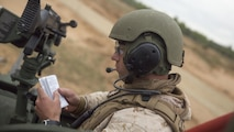 ADAZI, Latvia – Sgt. Christian Cook, a vehicle commander with Charlie Company, 4th Light Armored Reconnaissance Battalion, 4th Marine Division, Marine Forces Reserve, reads instructions to his crewmember before firing during Exercise Saber Strike 17 in the Adazi Training Area, Latvia, June 5, 2017. Exercise Saber Strike 17 is an annual combined-joint exercise conducted at various locations throughout the Baltic region and Poland. The combined training prepares NATO Allies and partners to effectively respond to regional crises and to meet their own security needs by strengthening their borders and countering threats. (U.S. Marine Corps photo by Cpl. Devan Alonzo Barnett/Released)