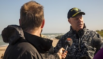 ADAZI, Latvia – Vice Adm. Christopher Grady, the Commander of Naval Striking and Support Forces, speaks to the media about the beach landing in Ventspils, Latvia, during Exercise Saber Strike and Baltic Operations 17, June 6, 2017. Marines from Bravo Company, 1st Battalion, 23rd Marine Regiment, 4th Marine Division, Marine Forces Reserve and 4th Air Naval Gunfire Liaison Company executed the beach assault. The purpose of Strike Force NATO is to deliver a rapidly deployable and scalable headquarters capable of planning and executing full-spectrum joint maritime operations to provide assurance, deterrence, and collective defense for the Alliance. (U.S. Marine Corps photo by Cpl. Devan Alonzo Barnett/Released)