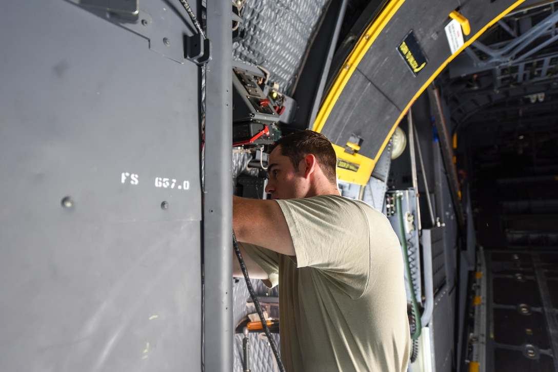 Airman 1st Class Anthony Hause, an electronic warfare journeyman with the 15th Aircraft Maintenance Unit, reassembles waveguide systems on an MC-130H Combat Talon II at Hurlburt Field, Fla., June 7, 2017. Electronic warfare specialists perform the USM670A test on the MC-130H Combat Talon II which ensures the radar jamming system produces the proper signals to prevent aircraft detection while in flight. (U.S. Air Force photo by Staff Sgt. Jeff Parkinson)