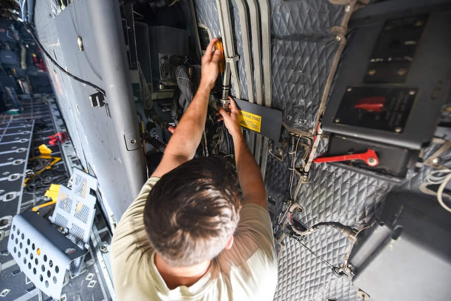 Airman 1st Class Anthony Hause, an electronic warfare journeyman with the 15th Aircraft Maintenance Unit, reassembles a waveguide system on an MC-130H Combat Talon II at Hurlburt Field, Fla., June 7, 2017. Waveguide systems allow the aircraft's radar jammer to produce the proper signals to effectively prevent aircraft detection while in flight. (U.S. Air Force photo by Staff Sgt. Jeff Parkinson)