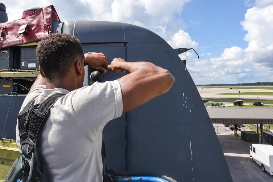 Airman 1st Class William Green, an electronic warfare specialist with the 15th Aircraft Maintenance Unit, re-installs an antenna mount on an MC-130H Combat Talon II during routine maintenance at Hurlburt Field, Fla., June 7, 2017. The antenna allows the aircraft to read and interpret different signals allowing the radar jammer to produce the correct signals and effectively prevent aircraft detection while in flight. (U.S. Air Force photo by Staff Sgt. Jeff Parkinson)