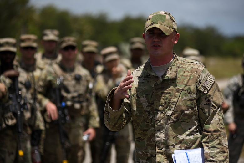 U.S. Air Force Tech. Sgt. Ryan Hyslop, Air Force Global Strike Command Det. 4 survival, evasion, resistance and escape specialist, briefs service members before a combat search and rescue training exercise at Andersen South, Guam, June 5, 2017. Service members from Task Force Talon (TFT), Helicopter Sea Combat Squadron Two-Five (HSC-25), and the 36th Wing joined together to practice survival, evasion, resistance and escape procedures, emergency evacuation techniques and quick reaction force training. This is the first time these units participated in a combat search and rescue exercise together on Guam. (U.S. Air Force photo/Staff Sgt. Joshua Smoot)