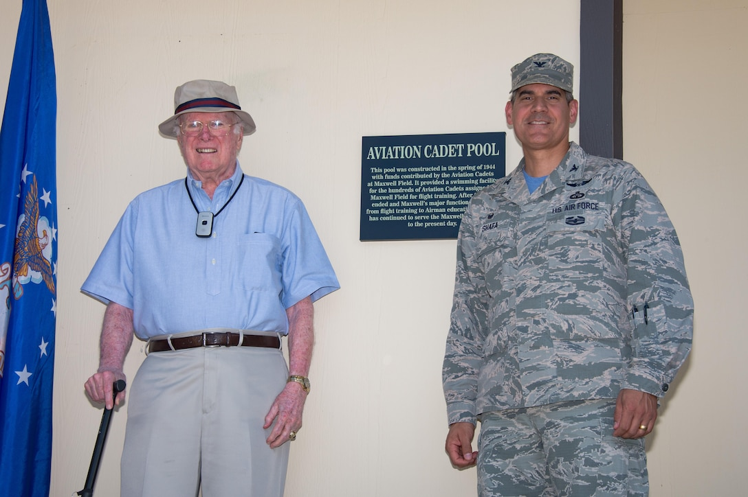 Col. Eric Shafa, 42nd Air Base Wing Commander, and reitred Col. William Quinn, former aviation cadet at Maxwell Air Force Base, Ala., renames the Maxwell Community Pool as the Aviation Cadet Pool, June 9, 2017. The pool was constructed in  1944 with funds contributed by the Aviation Cadets at Maxwell Field. It provided a swimming facility for the hundreds of Aviation Cadets assigned to Maxwell Field for flight training.  (US Air Force photo by Melanie Rodgers Cox)