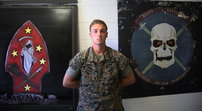 Cpl. Blake Cannon stands proudly in front of B Battery unit logos at Marine Corps Air Station Cherry Point, N.C., June 9, 2017. Cannon is a team leader assigned to 1st platoon of B Battery, 2nd Low Altitude Air Defense Battallion, Marine Air Control Group 28, and takes on the responsibilty of training the Marines in his team to the highest standards. (U.S. Marine Corps photo by Pfc. Skyler Pumphret/ Released)