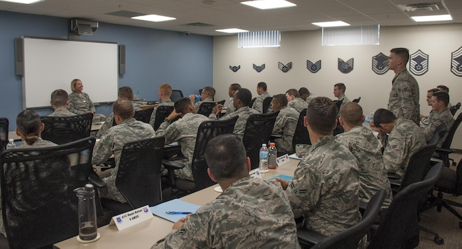 Chief Master Sgt. Melanie K. Noel, left, Command Chief assigned to the 6th Air Mobility Wing, talks to First Term Airmen Course Airmen at MacDill Air Force Base Fla., June 9, 2017. The FTAC Airmen were the first MacDill Airmen to graduate the new course known as Airmanship 300. (U.S. Air Force photo by Airman 1st Class Mariette Adams)