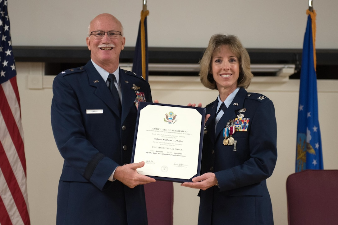 Col. Kathryn Pfeifer (right), outgoing commander of the 123rd Mission Support Group, receives her Certificate of Retirement from retired Maj. Gen. Mark Kraus, former Air National Guard assistant to the commander, United States Air Forces Central and a former assistant adjutant general for Air, Kentucky National Guard, during a ceremony held in Pfeifer's honor at the Kentucky Air National Guard Base in Louisville, Ky., Jan. 7, 2017. Pfeifer is retiring after more than 28 years of service. (U.S. Air National Guard photo by Staff Sgt. Joshua Horton)