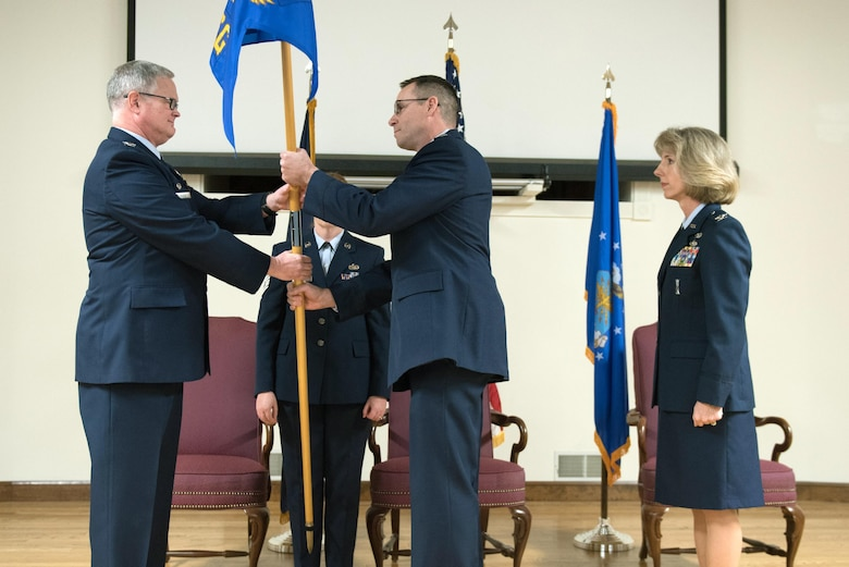 Lt. Col. Patrick Pritchard (center) assumes command of the 123rd Mission Support Group as he accepts the unit's guidon from Col. David Mounkes (left), commander of the 123rd Airlift Wing, during a change-of-command ceremony held at the Kentucky Air National Guard base in Louisville, Ky., Jan. 7, 2017. Pritchard replaces Col. Kathryn Pfeifer (right), who retired after more than 28 years of service. (U.S. Air National Guard photo by Staff Sgt. Joshua Horton)