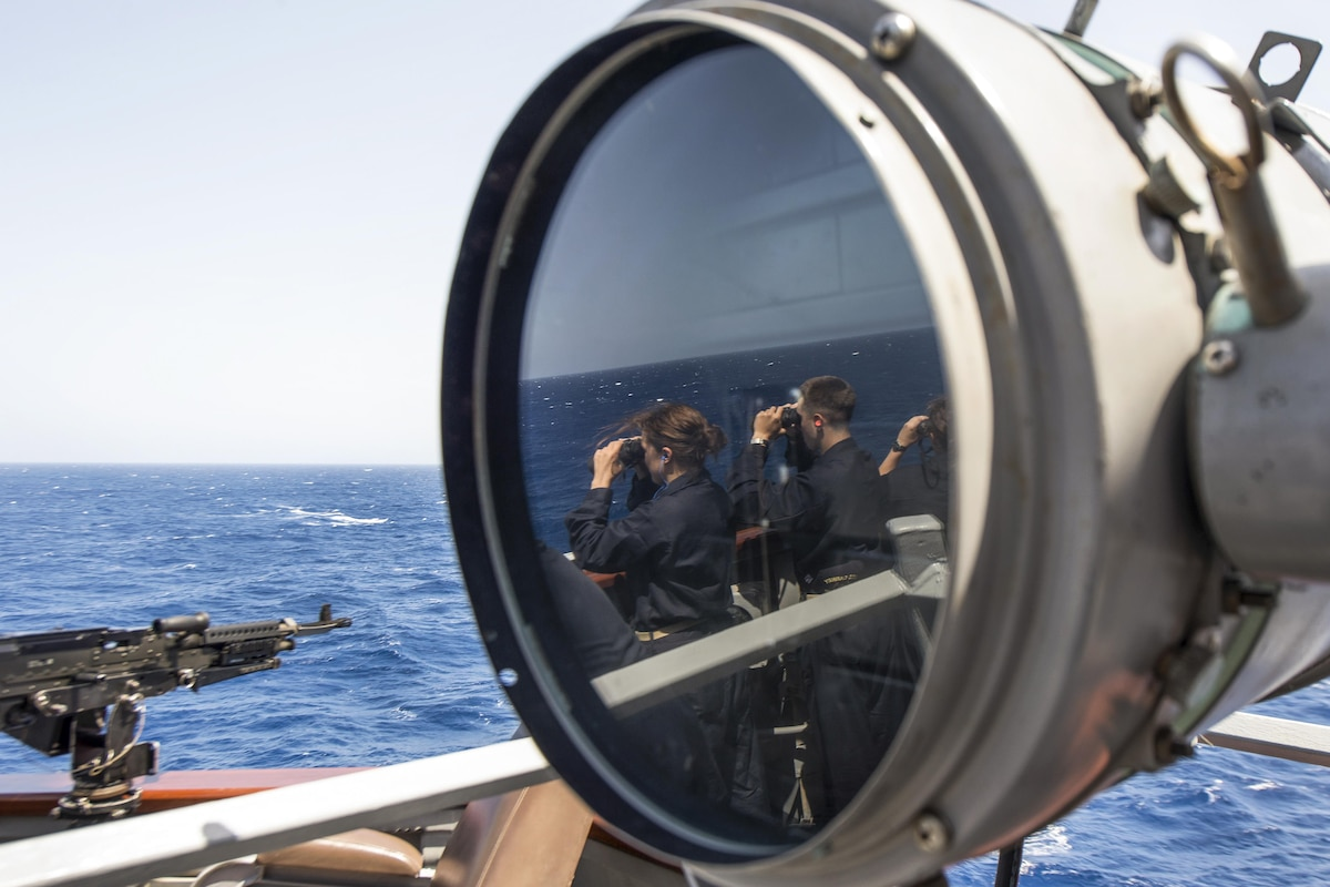 A reflection of midshipmen searching for surface contacts