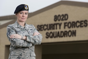 Tech Sgt. Michelle Aberle, 802nd Security Forces Squadron installation security, poses for a photo after conducting a security check on the base fence line May 9, 2017, at Joint Base San Antonio-Lackland, Texas. Aberle and Tech. Sgt. Paul Turner, also 802 SFS installation security, provide force protection for base personnel, equipment and facilities from threats to include intrusions by unauthorized people. (U.S. Air Force photo by Sean Worrell)