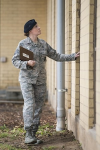 Technical Sgt. Michelle Aberle, 802nd Security Forces Squadron installation security, leaves the Base Defense Operation Center after conducting a building security check May 9, 2017, at Joint Base San Antonio-Lackland, Texas.  Aberle provides force protection for base personnel, equipment and facilities from threats to include intrusion by unauthorized people.