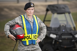 Technical Sgt. Michelle Aberle, 802nd Security Forces Squadron installation security, poses for a photo prior to conducting a security check May 9, 2017, at Joint Base San Antonio-Lackland, Texas.  Aberle and Turner provide force protection for base personnel, equipment and facilities from threats to include intrusion by unauthorized people. (Photo by Sean Worrell)