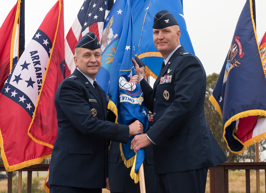 Lt. Gen. David Buck, commander, 14th Air Force (Air Forces Strategic) and Joint Functional Component Command for Space, presents the 30th Space Wing guidon flag to the incoming 30th SW commander, Col. Michael Hough, during a change of command ceremony, June 9, 2017, Vandenberg Air Force Base, Calif. (U.S. Air Force photo by Michael Peterson/Released)