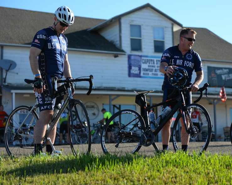 Maj. Anthony Bares, the director of inspections assigned to the 28th Bomb Wing Inspector General office, and Capt. Eben Engler, a B-1 Bomber weapon systems officer assigned to the 34th Bomb Squadron, prepare to continue the Ride Across South Dakota bike tour in Caputa, S.D., June 4, 2017. The Air Force Cycling Team has over 150 members, and supports other cyclists during the Register's Annual Great Bicycle Ride Across Iowa whether it is promoting the Air Force or fixing bicycles on the route. (U.S. Air Force photo by Airman Nicolas Z. Erwin)