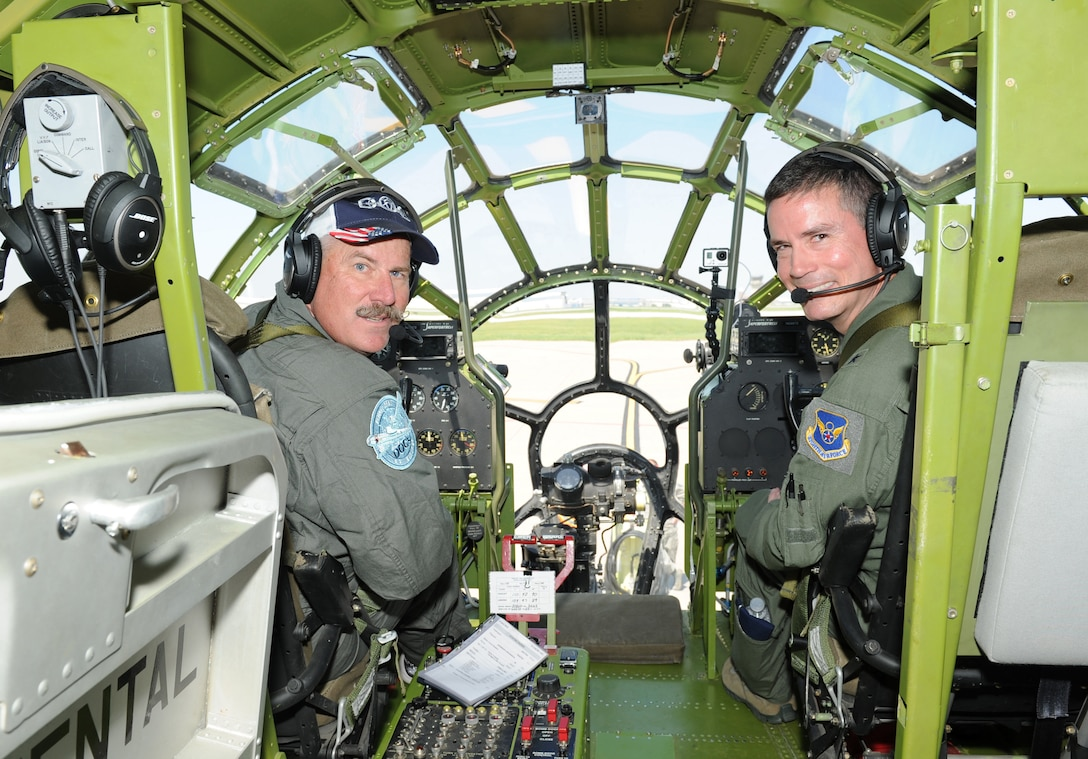Mark Novak, left, a B-29 Superfortress pilot and Brig. Gen. Paul Tibbets IV, 509th Bomb Wing commander, Whiteman Air Force Base, Mo., pose for a photo inside Doc, a restored B-29 Superfortress, June 9, 2017, on McConnell AFB, Kan. Tibbets' grandfather, retired Brig. Gen. Paul Tibbets Jr., piloted the B-29 during WWII. (U.S. Air Force photo/Senior Airman Tara Fadenrecht)