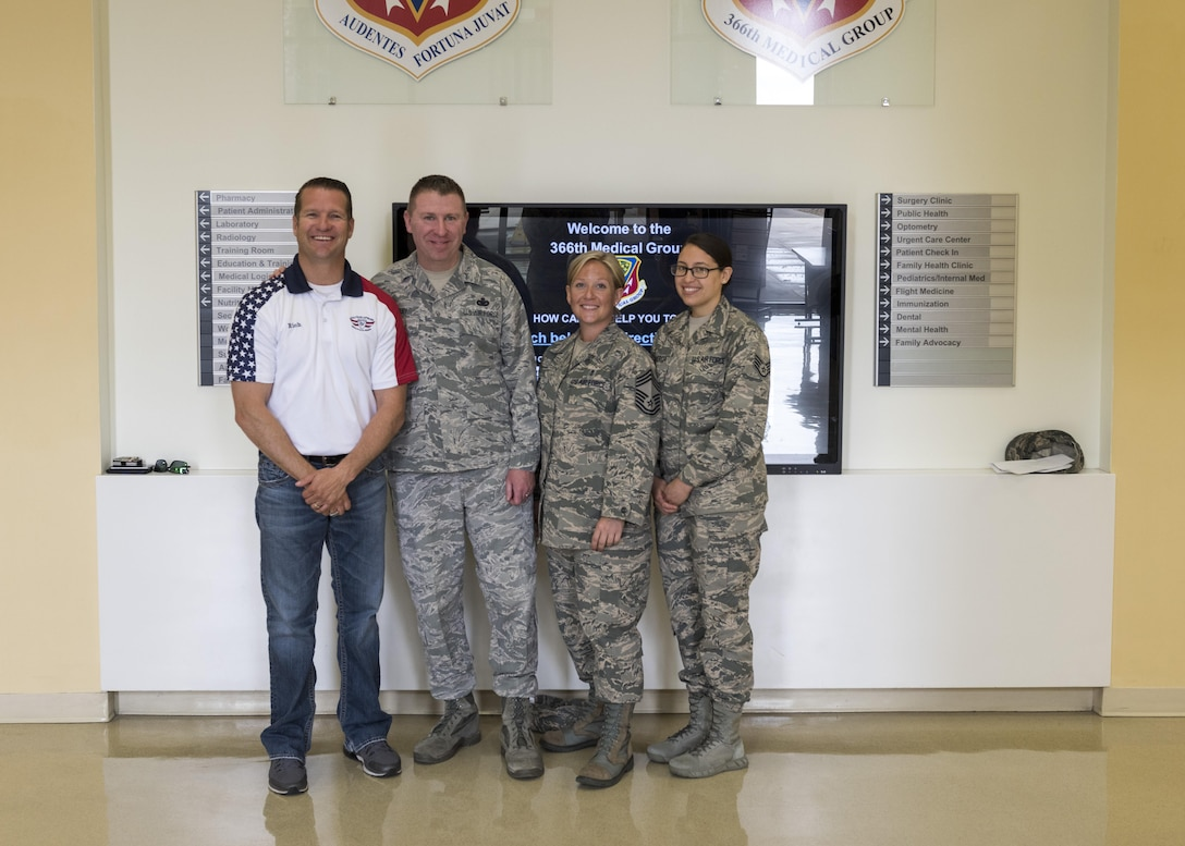 Rich Sykes, Mountain Home mayor, poses for a photo with Chief Master Sgt. Chad Bickley, 366th Fighter Wing command chief, and other medical airmen, June 1, 2017, at Mountain Home Air Force Base, Idaho. Before Sykes' orientation flight he had to have a flight physical to determine if he way cleared to fly.(U.S. Air Force Photo by Senior Airman Jeremy L. Mosier)